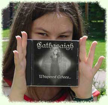 Cathasaigh holding a copy of Whispered Echoes